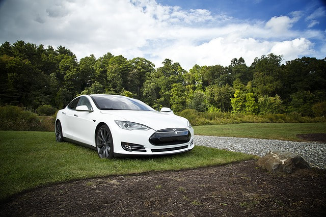 White Tesla Electric Car Requires Professional Auto Repairs and Maintenance